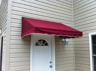 red canvas awning covering door of home in Raleigh, NC