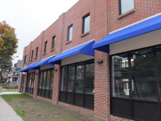 blue window canopies in Raleigh covering office building windows