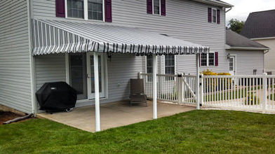 residential awning covering Raleigh patio in backyard