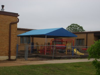 blue canopy covering playground equipment in Raleigh