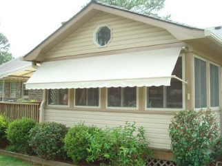 opened residential retractable window awning on Raleigh home